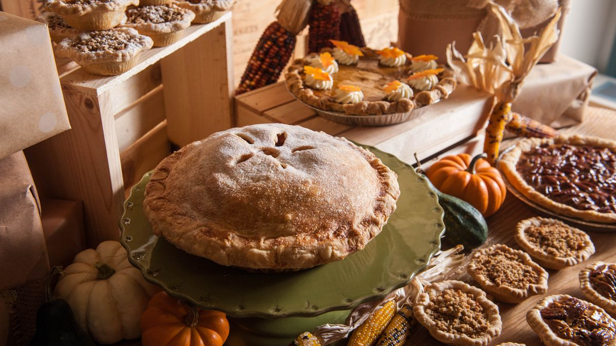 Picture of a table full of pies to represent a Thanksgiving dessert table