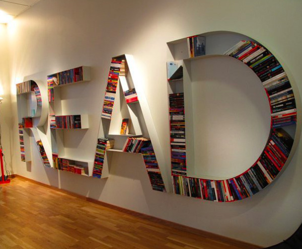 This photo is of four letters R-E-A-D to highlight our Principal's Book Club.  Each letter is a bookshelf and contains books.