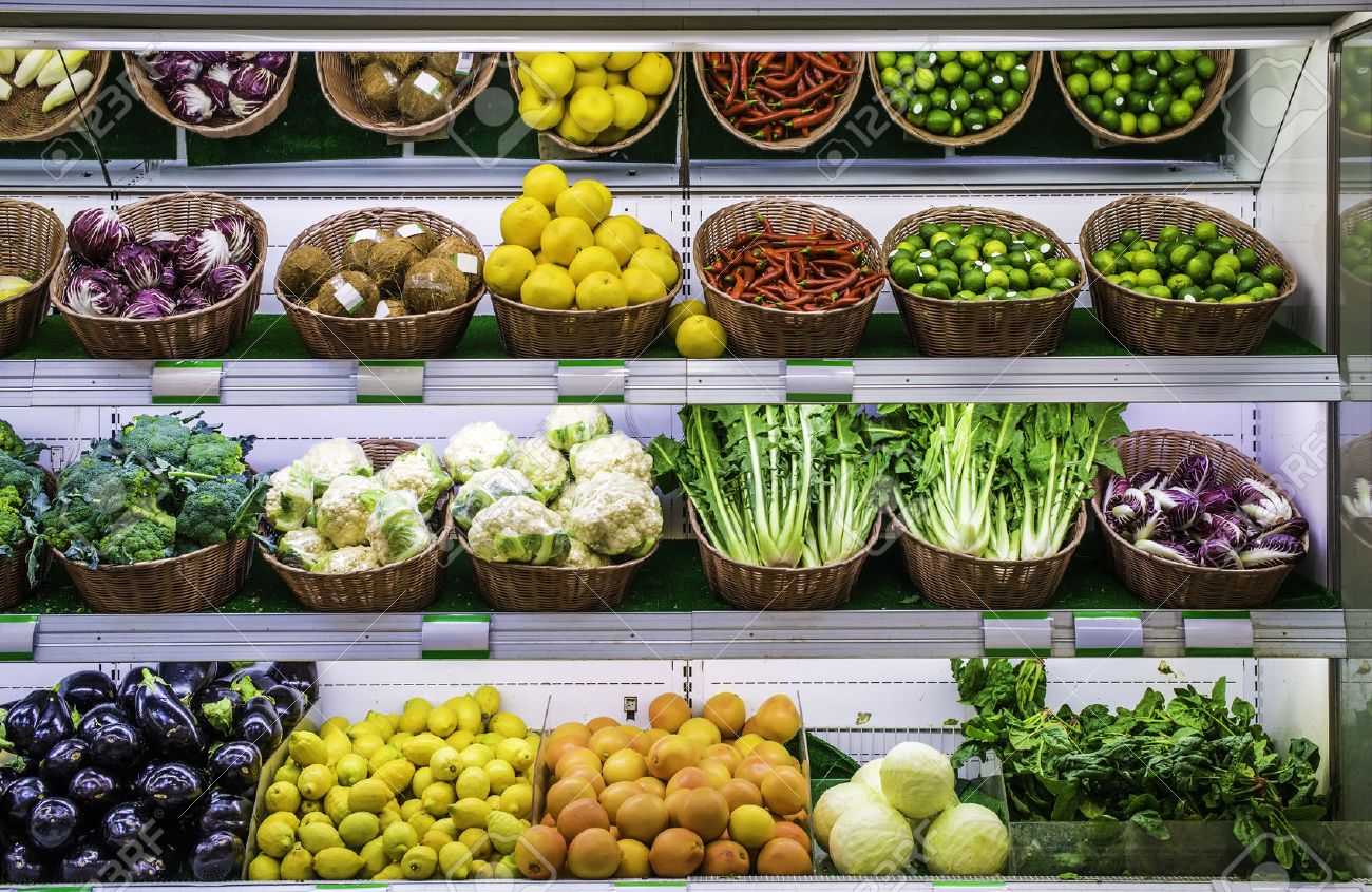 Photo of fruits and vegetables in a supermarket display case