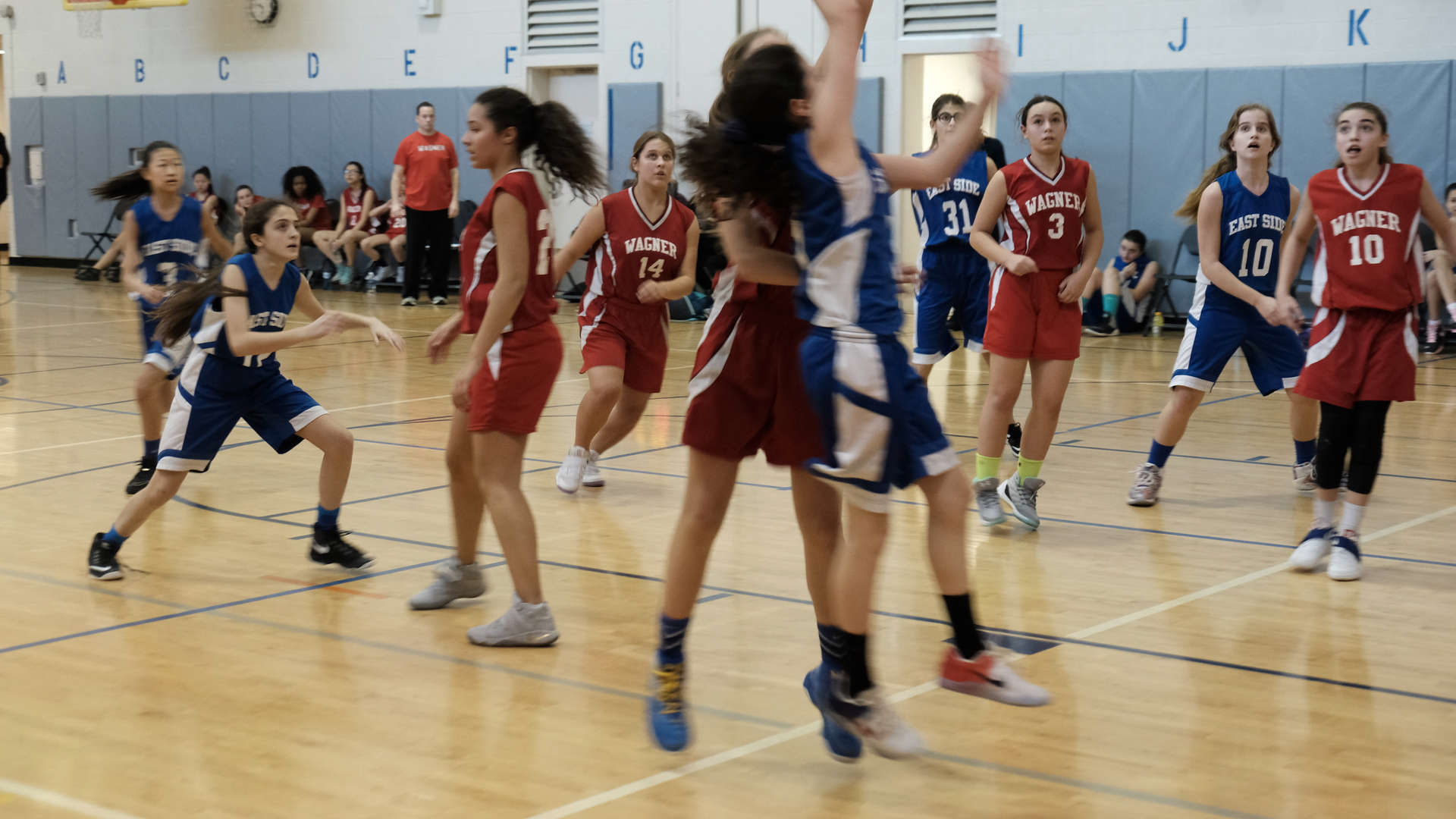 A photo of a girls basketball game, ESMS vs Wagner