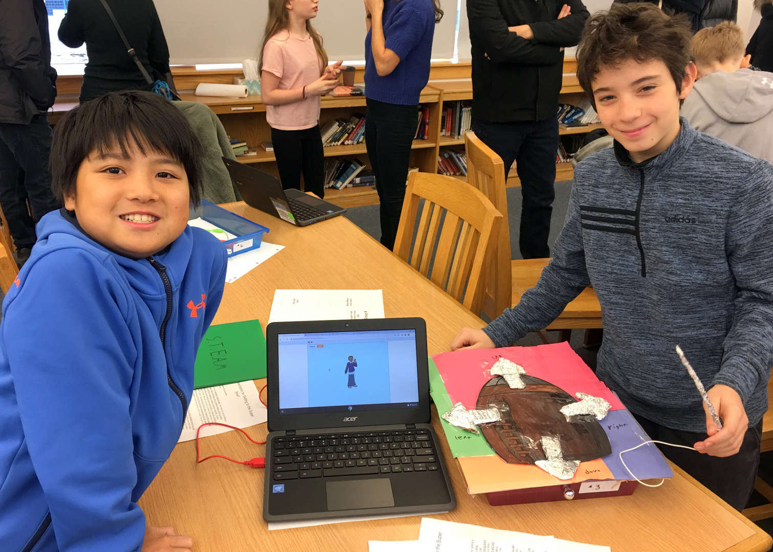 Children displaying their projects at ESMS STEAM Open House, Feb 10 2020