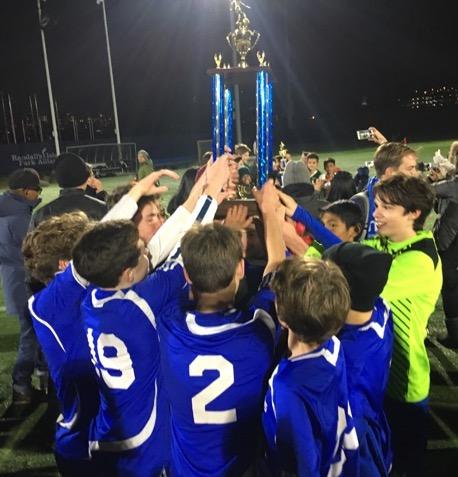 Boys Varsity Soccer Champs holding trophy