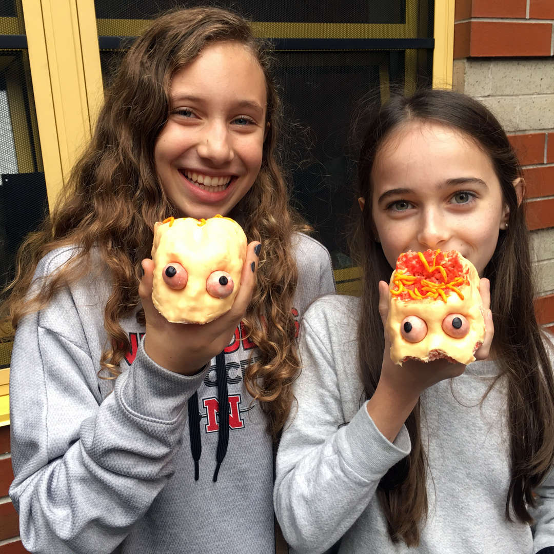 """Photo of students eating """"scary"""" Halloween cookies"""