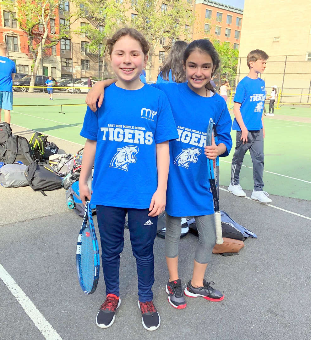 Photo of two students from the ESMS tennis team