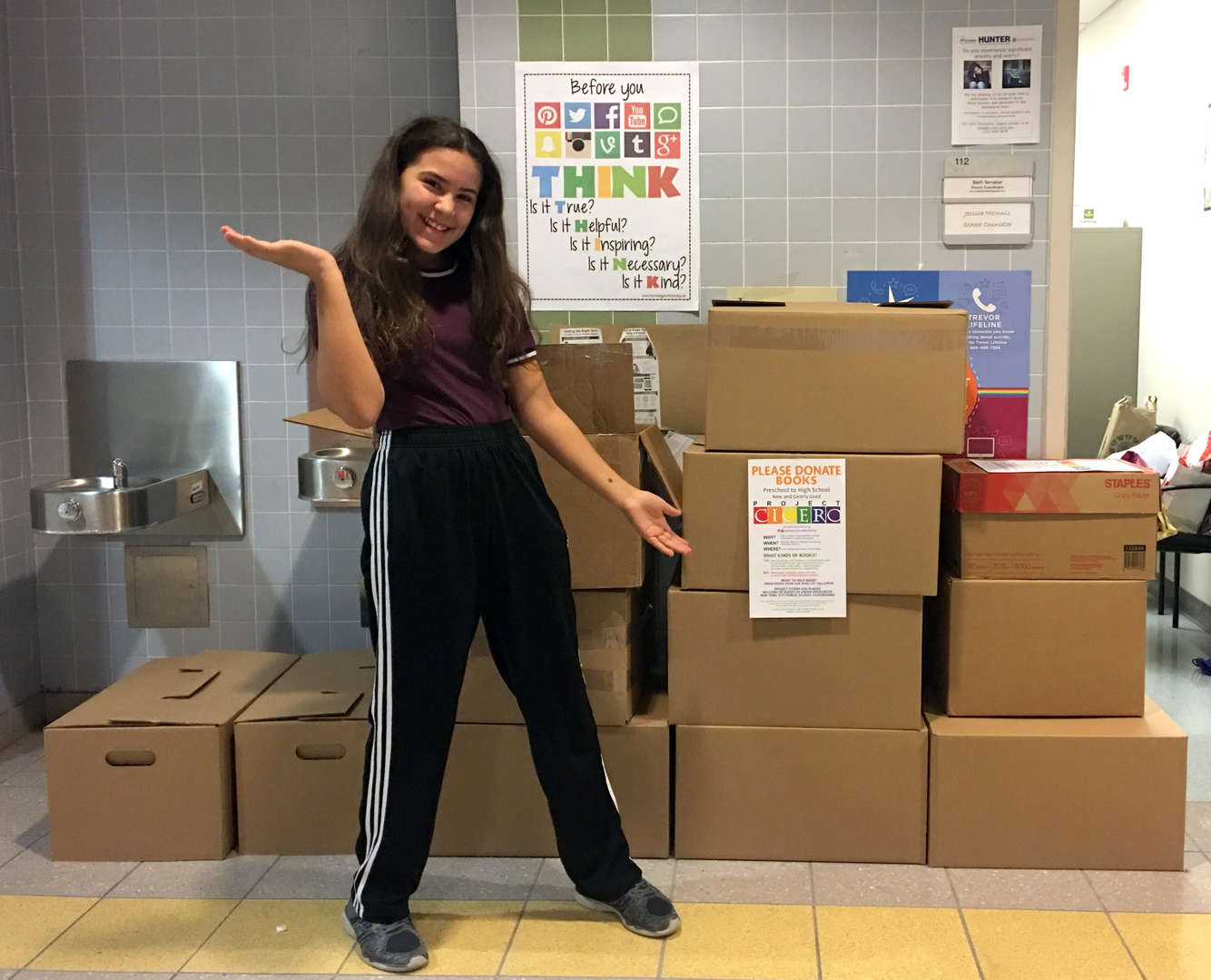 Photo - Student in front of Project Cicero boxes