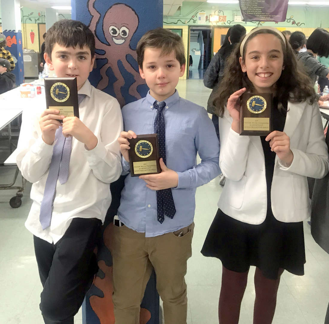 Photo - three ESMS students (two boys, one girl) with debate team awards