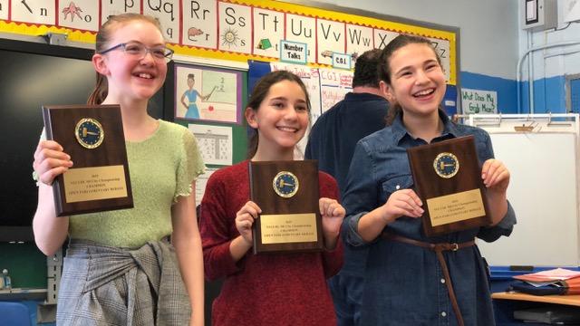 Photo of three ESMS girls with debate team awards