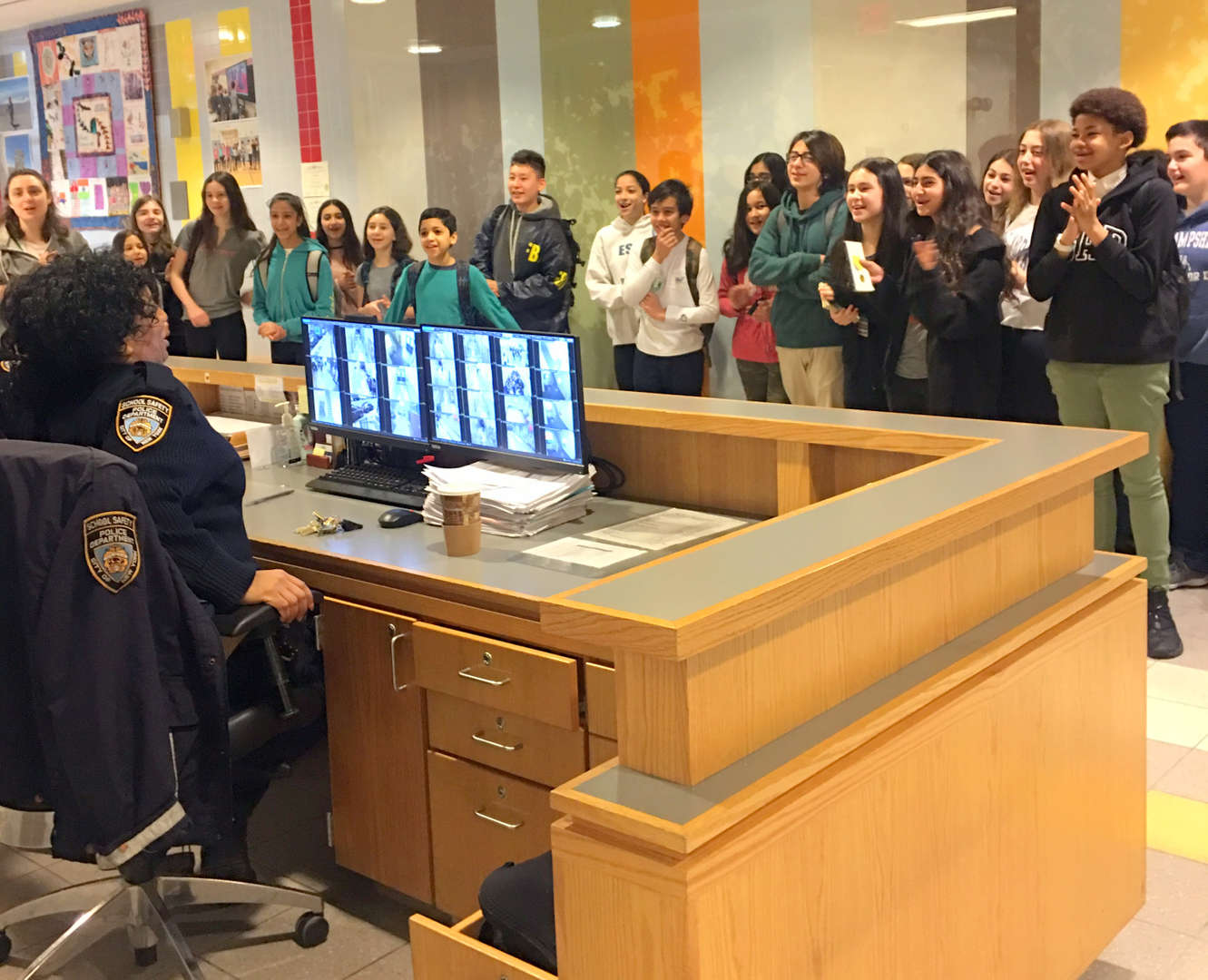 Photo of students singing happy birthday to Agent Skinner