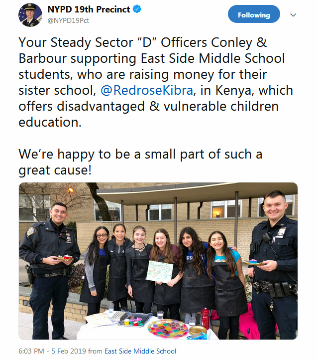 A twitter tweet showing ESMS Bake Sale kids with NYPD