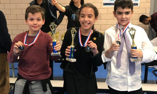 Photo - three ESMS students (two boys, one girl) with debate team awards 2019