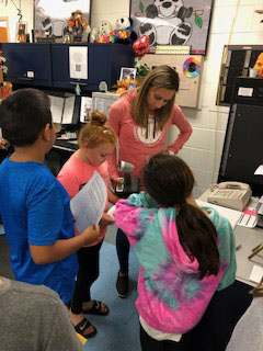 Mrs. Zulauf and her students share their collaborative citizenship work with the school.