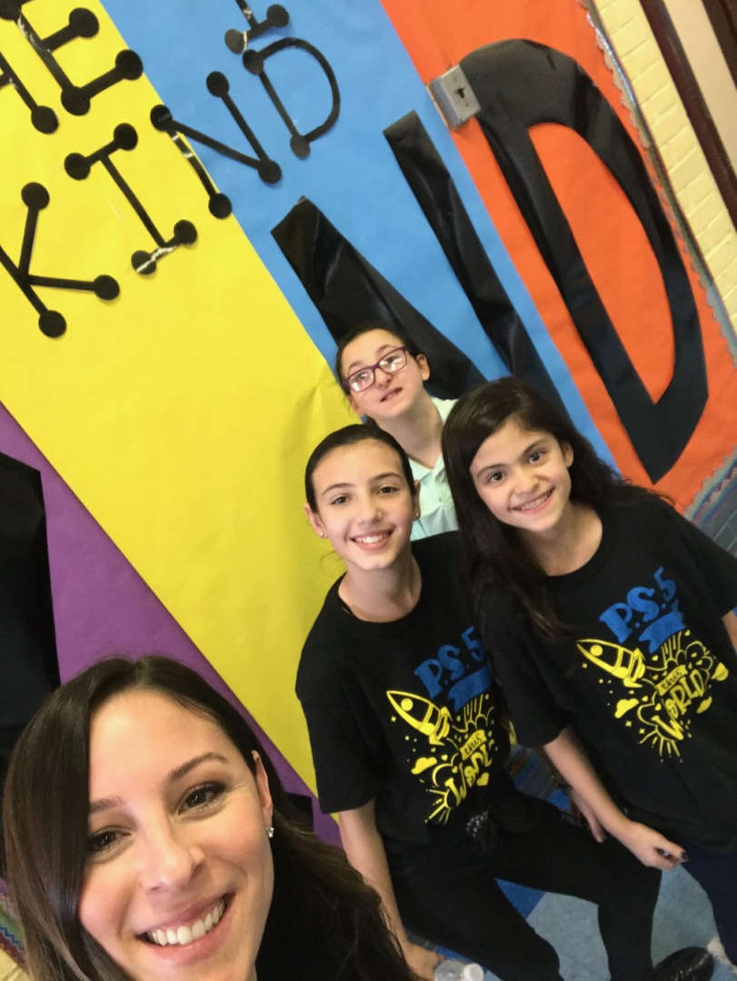 Students in front of Be Kind Poster