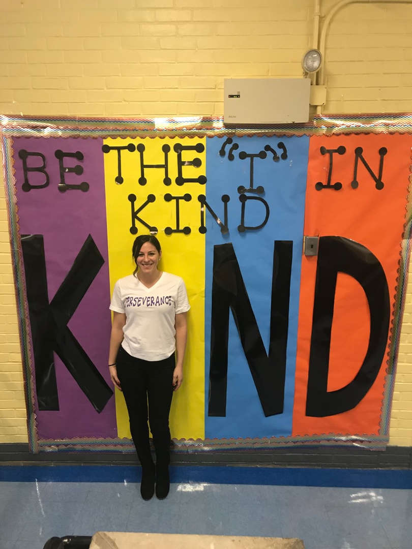 Mrs. Lanza in front of Be Kind Poster
