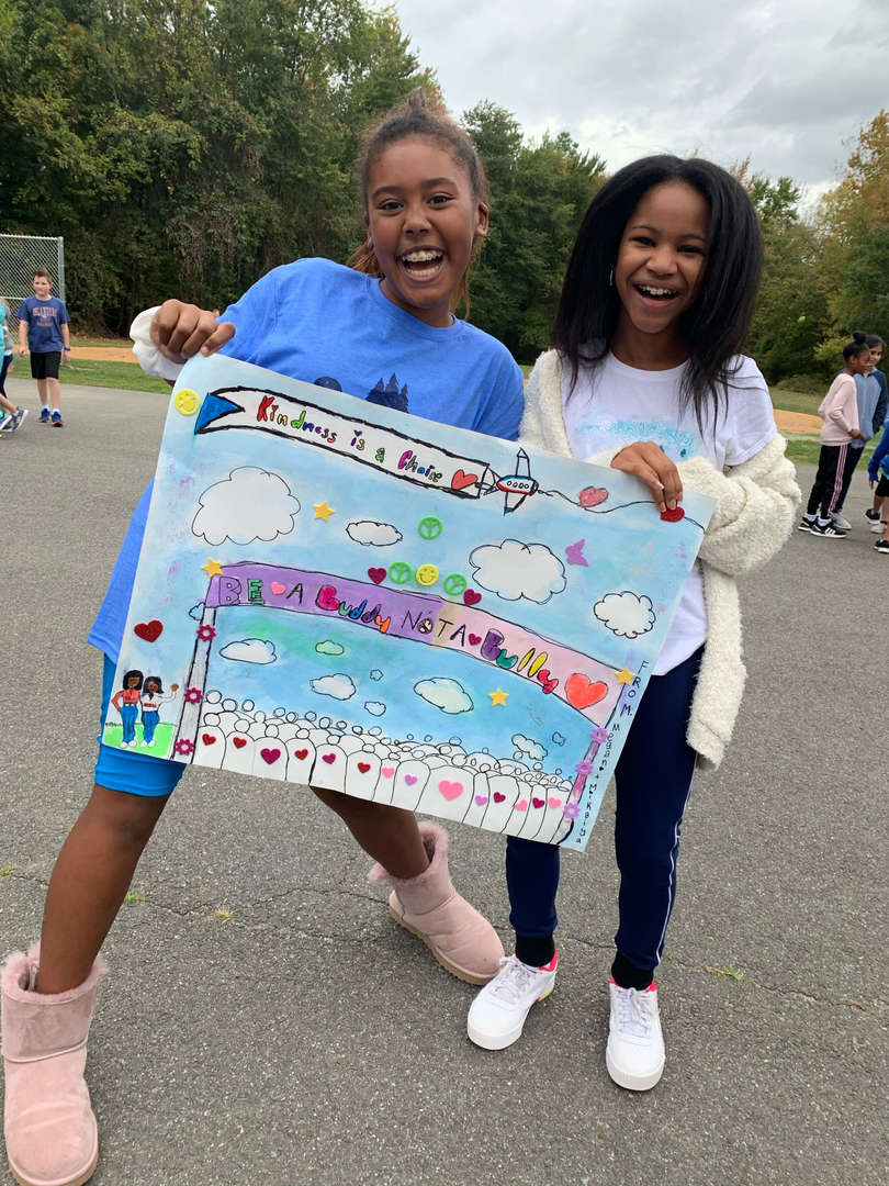 Be a Buddy Not a Bully poster displayby two girls