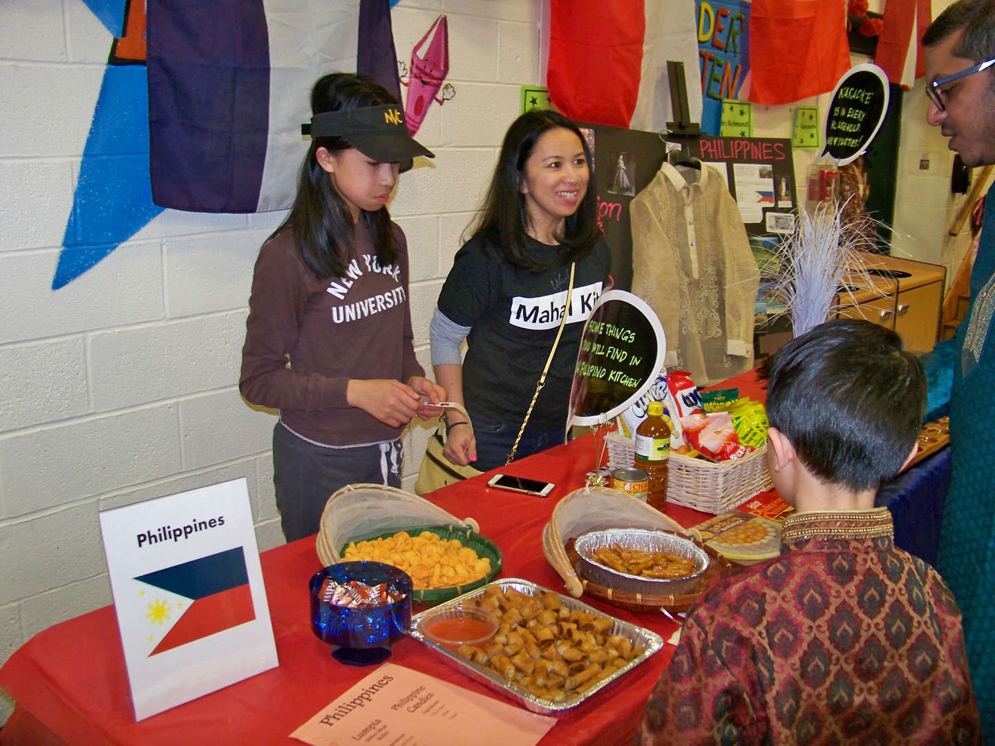 Philippine food display with mother and daughter