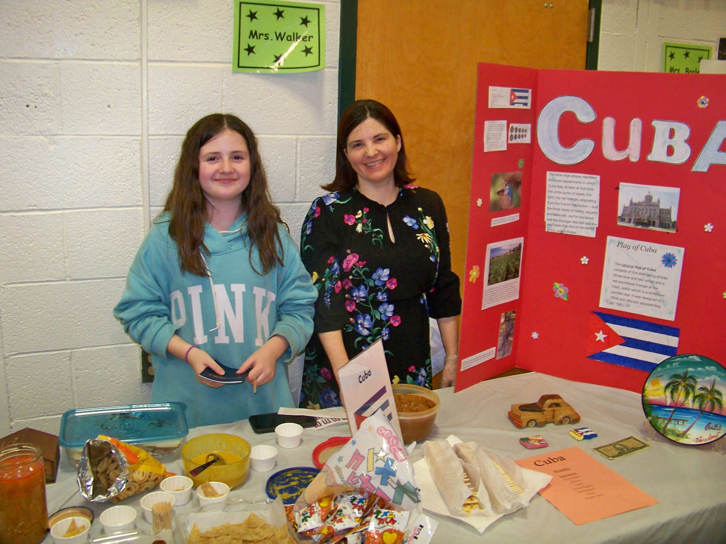 Cuban food display with mother and daughter
