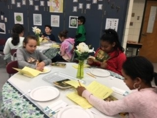 Students read books in book-tasting setting!