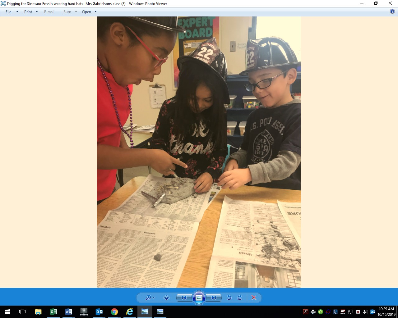 Digging for Dinosaur Fossils wearing hard hats! Mrs.Gabrielson's class