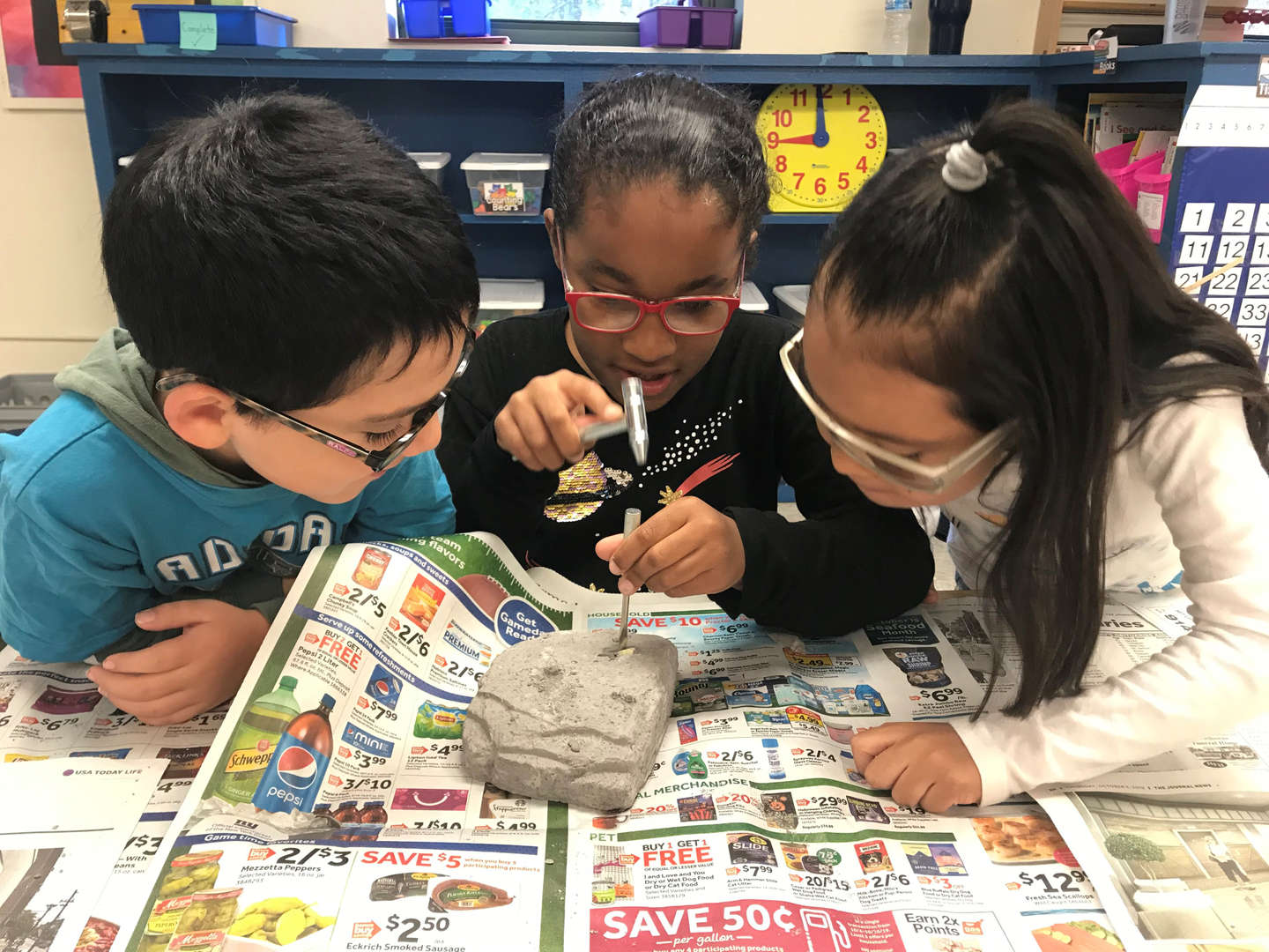 Digging for Dinosaur Fossils, chipping away at rock- Mrs. Gabrielson's 3 students