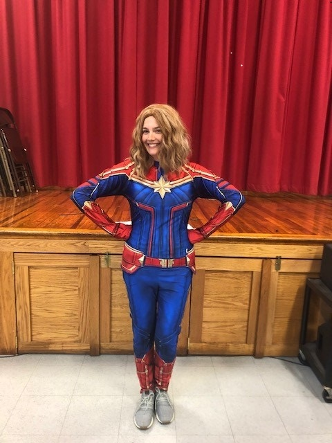 """Winner of the """"What would you do for VCE"""" contest for PTA fundraiser. Mrs. Christina Clark dressed as Captain Marvel!"""