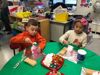Kindergarten tradition of making gingerbread houses.