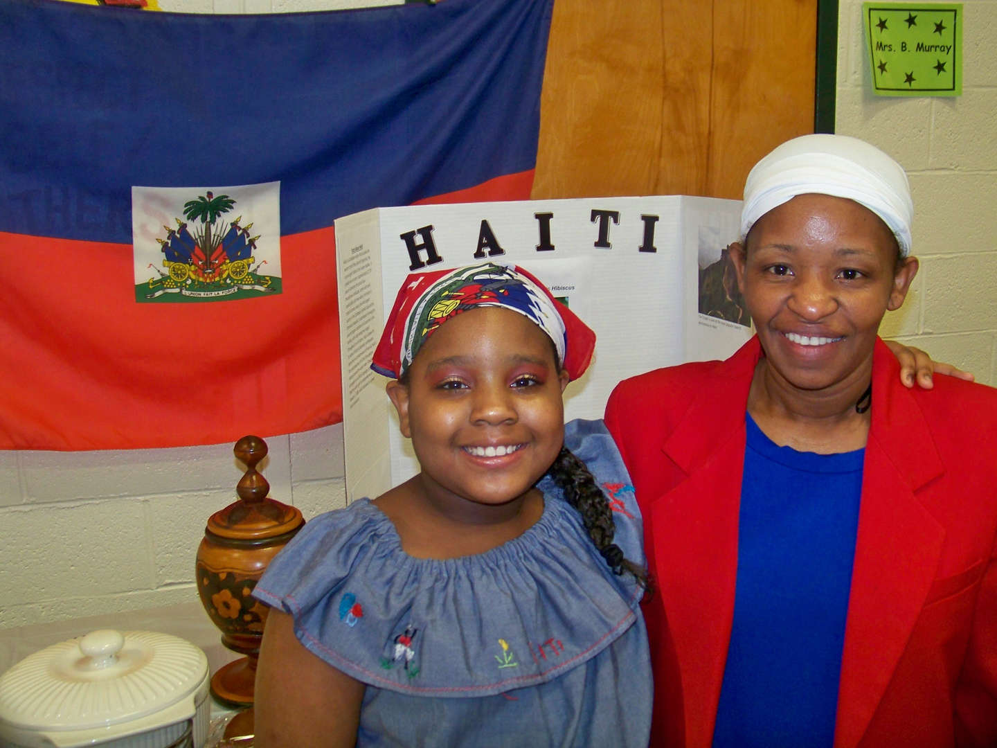 Mother and daughter pose for Haiti