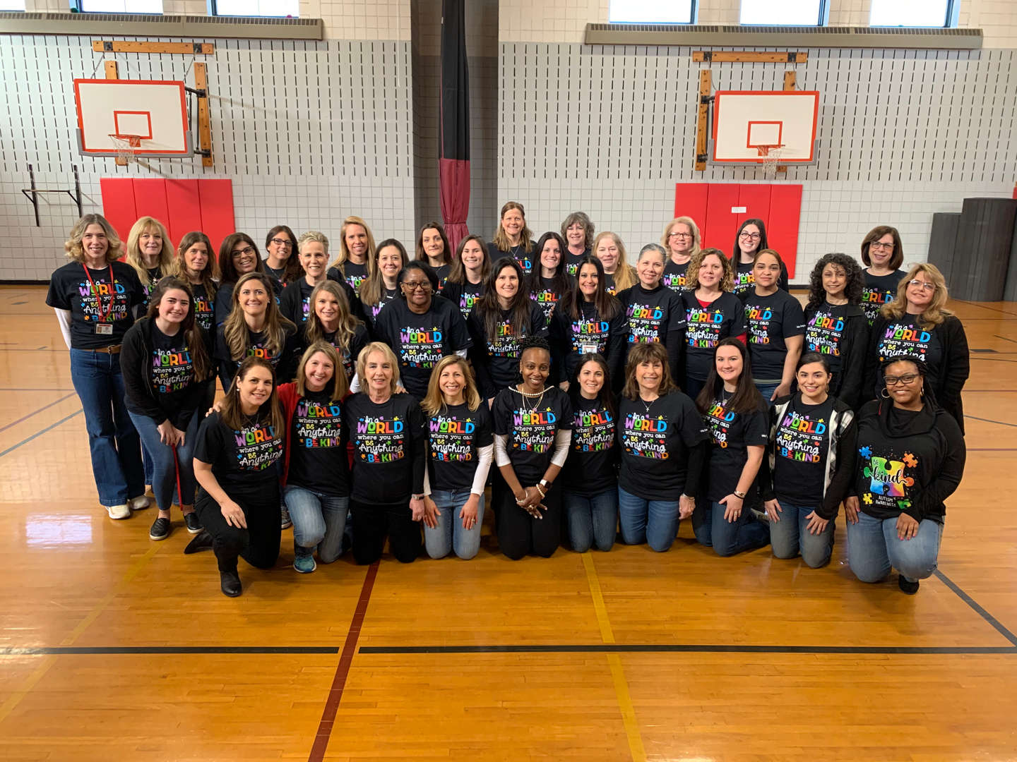 Staff Photo wearing Be Kind shirts!