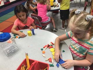 Kindergarten exploring math manipulatives