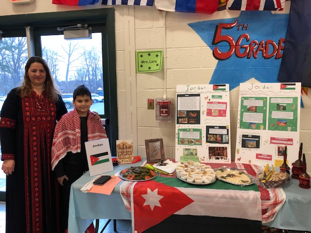 Family representing Jordan and food display
