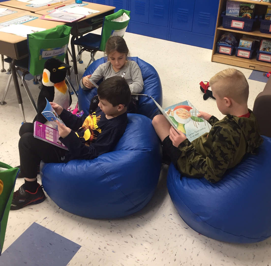 2nd Graders reading in the Cozy Corner