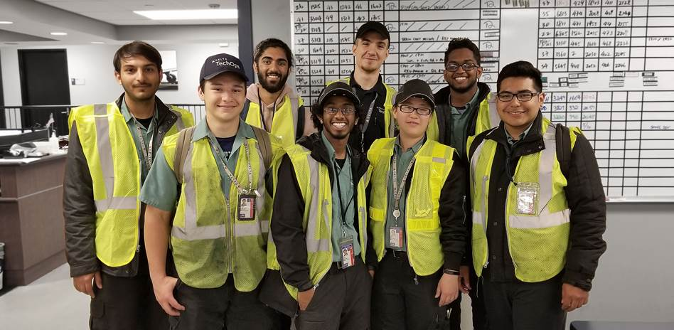 Our 2018 Annex Delta Air Lines Interns in Safety Vests in Delta Office