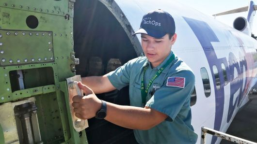 Picture of a fifth year student working on our 727 from a CNBC feature on Aviation High School.