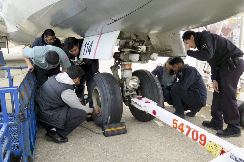 Image of 5th year students working on the school's 727 from an NPR story.