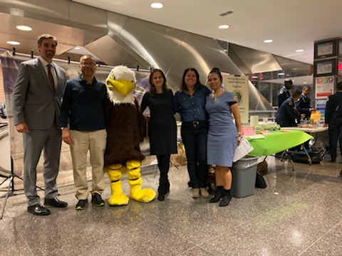 Our Principal Mr. Steven R. Jackson, joined by our school Mascot and volunteers from our Parent Association executive board joined us for our October 2019 Parent teacher conferences. Here they are in the entrance of our school fund raising and engaging Aviation High School Families.