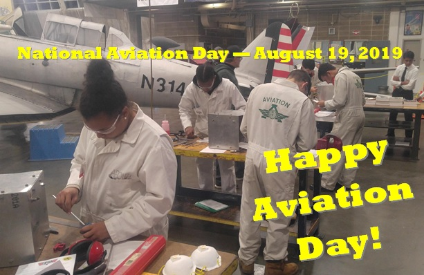 Our seniors working in the hangar on projects. The picture is a representation in honor of National Aviation Day 2019!