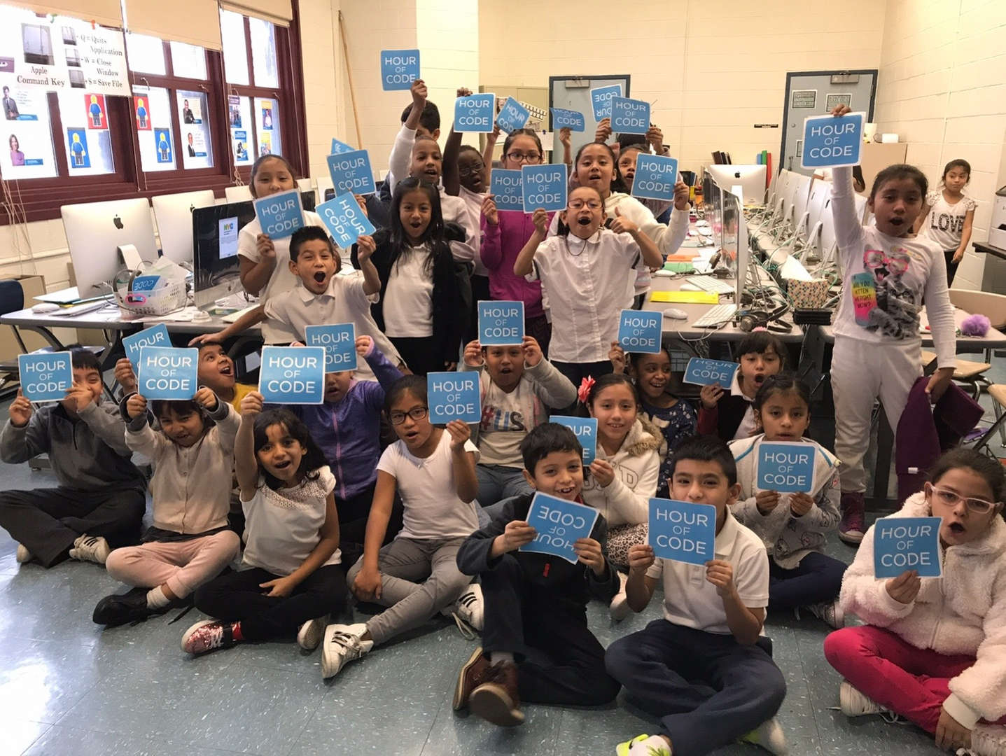 the entire 4th grade class posing with their hour of code certificates
