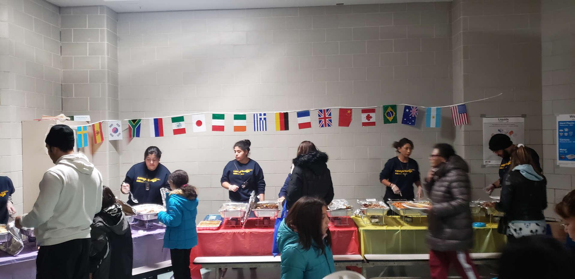 parent association serving international food for visitiors