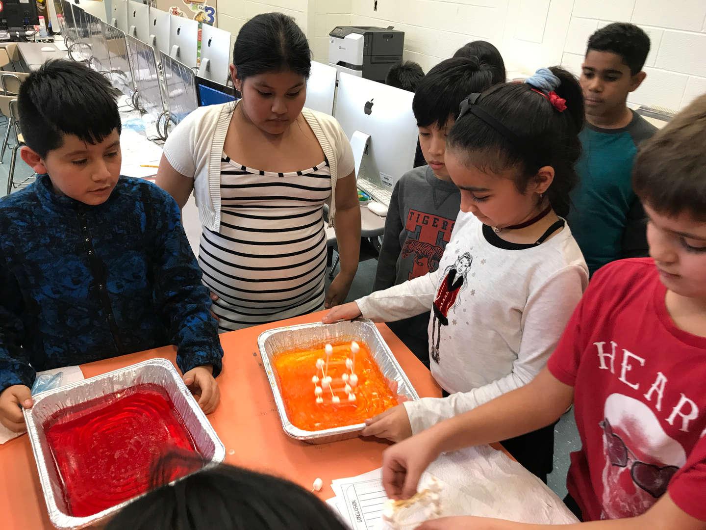 5 kids testing their tower on jello