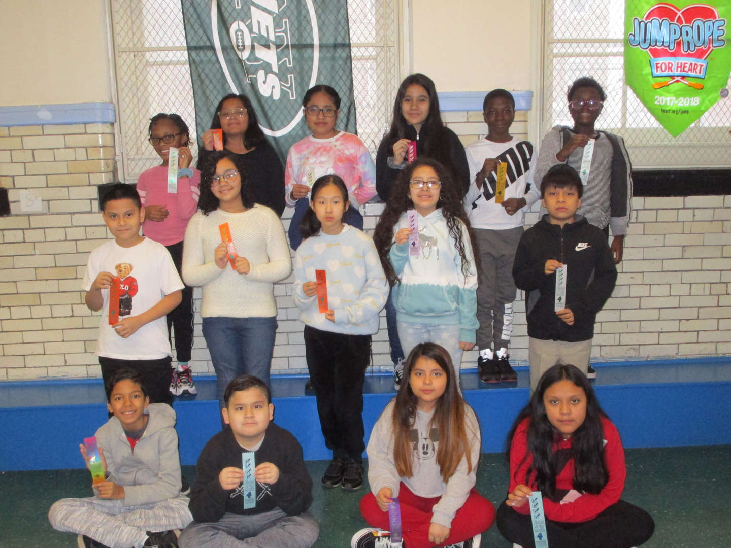 group of students standing with student of the month badge
