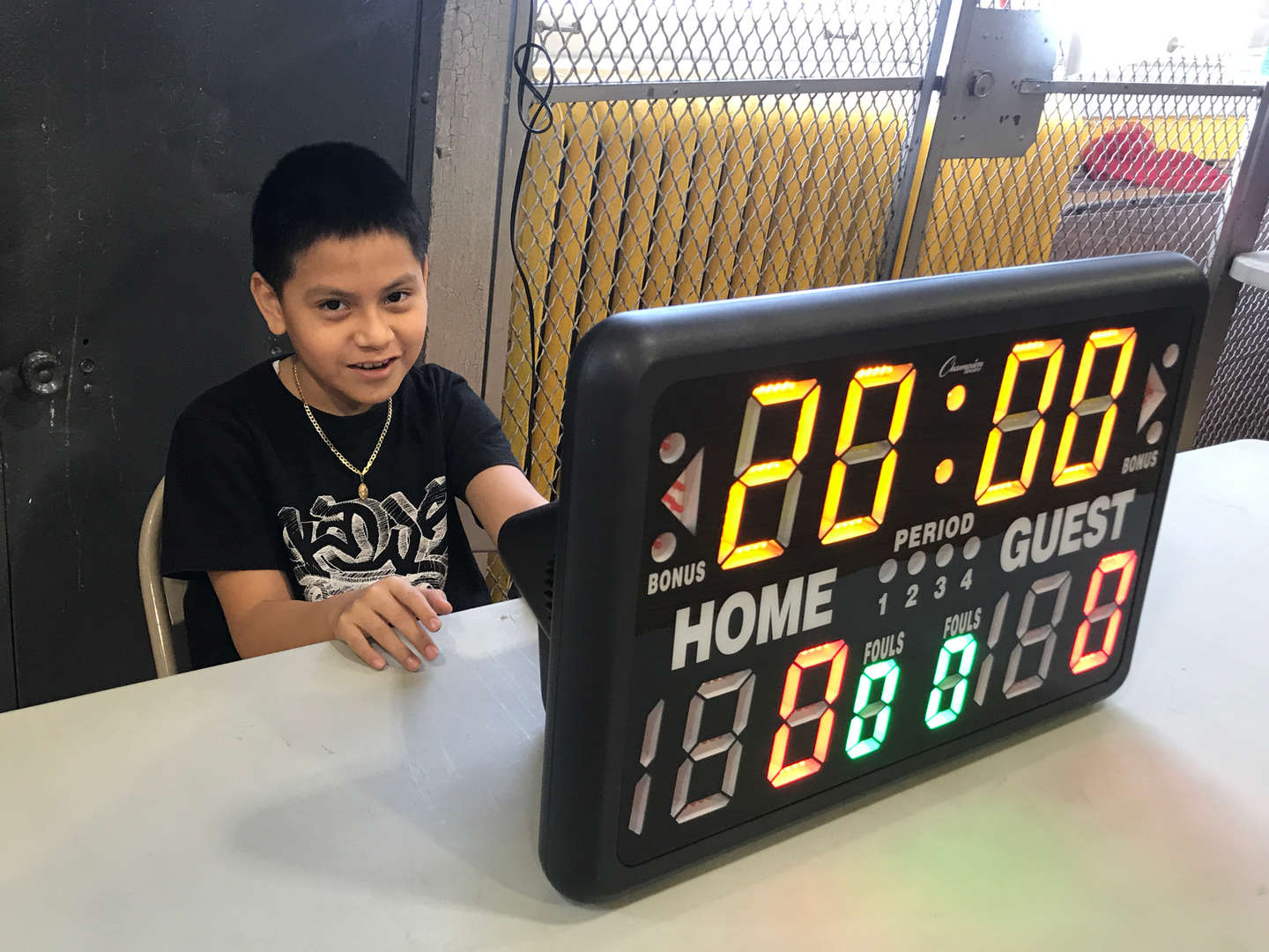 score keeper at the table with the digital display