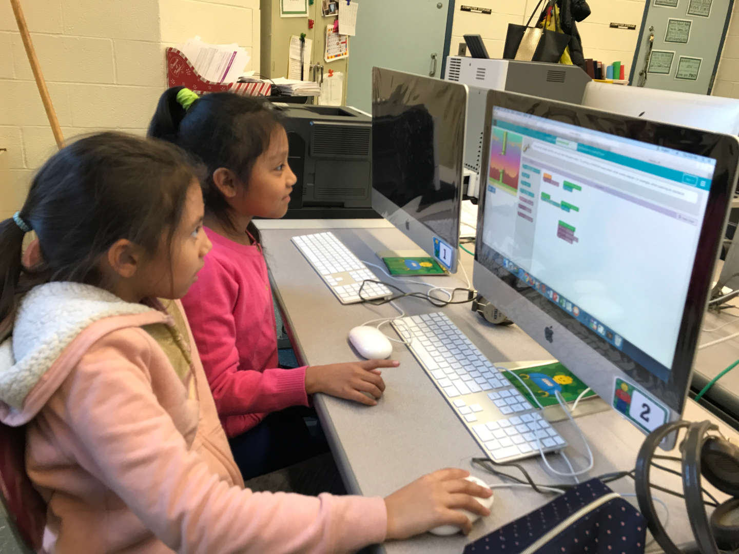 2 girls coding at the computer coding