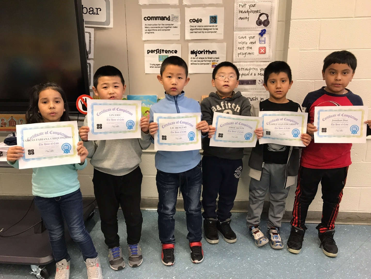 2nd grade boys holding their coding certificates