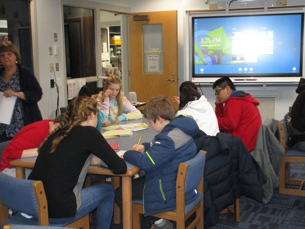Hotchkiss students mentoring Sharon students
