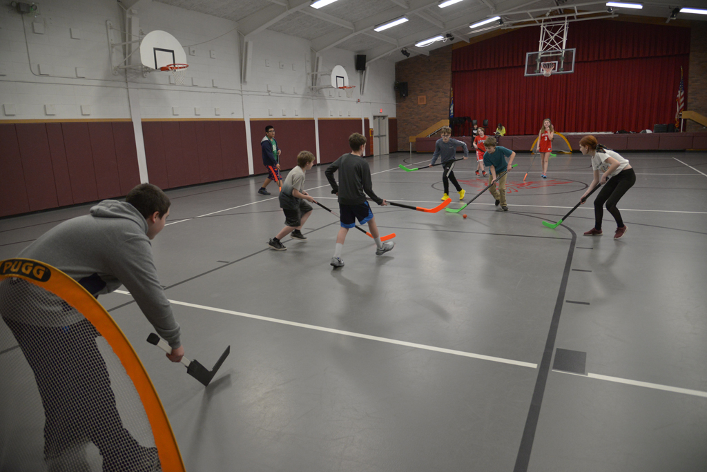 Students playing LaCrosse