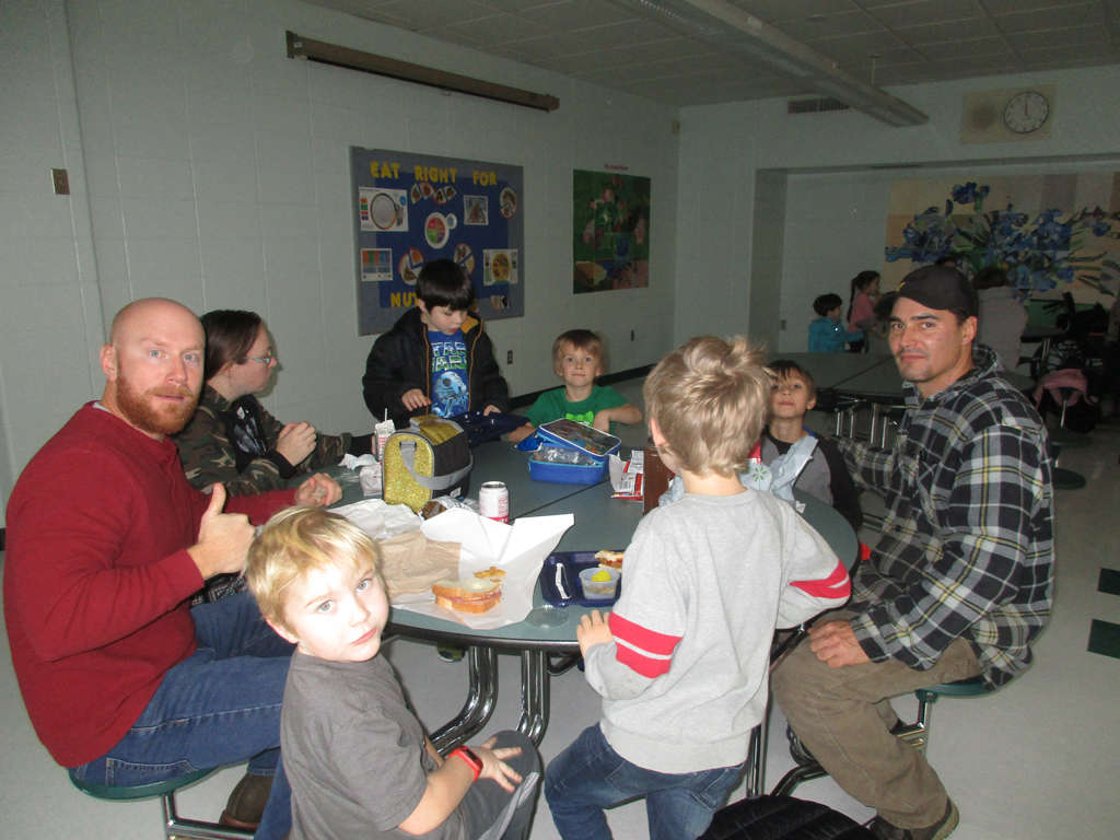 Group of parents and students in the lunch room