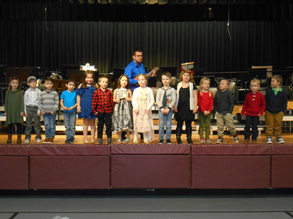 Kindergarten students singing in concert