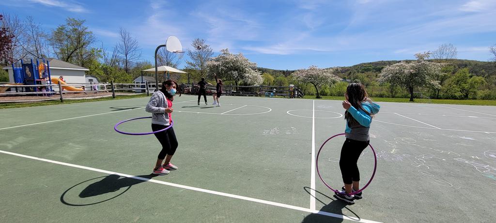girls playing hoola hoops