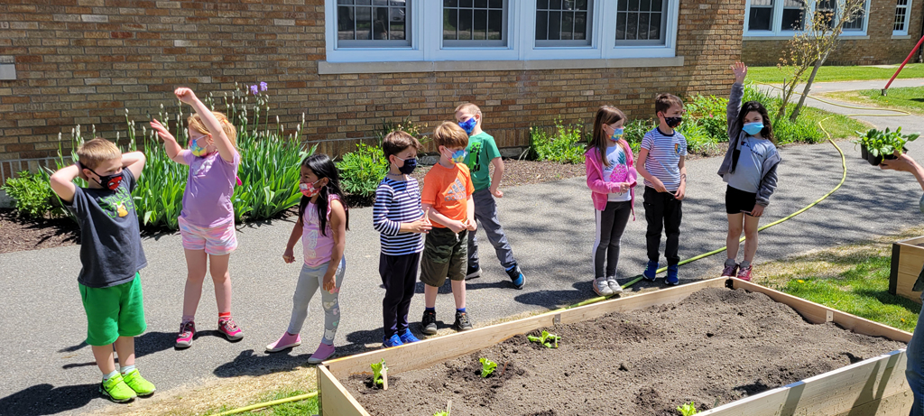 First graders plant vegetables