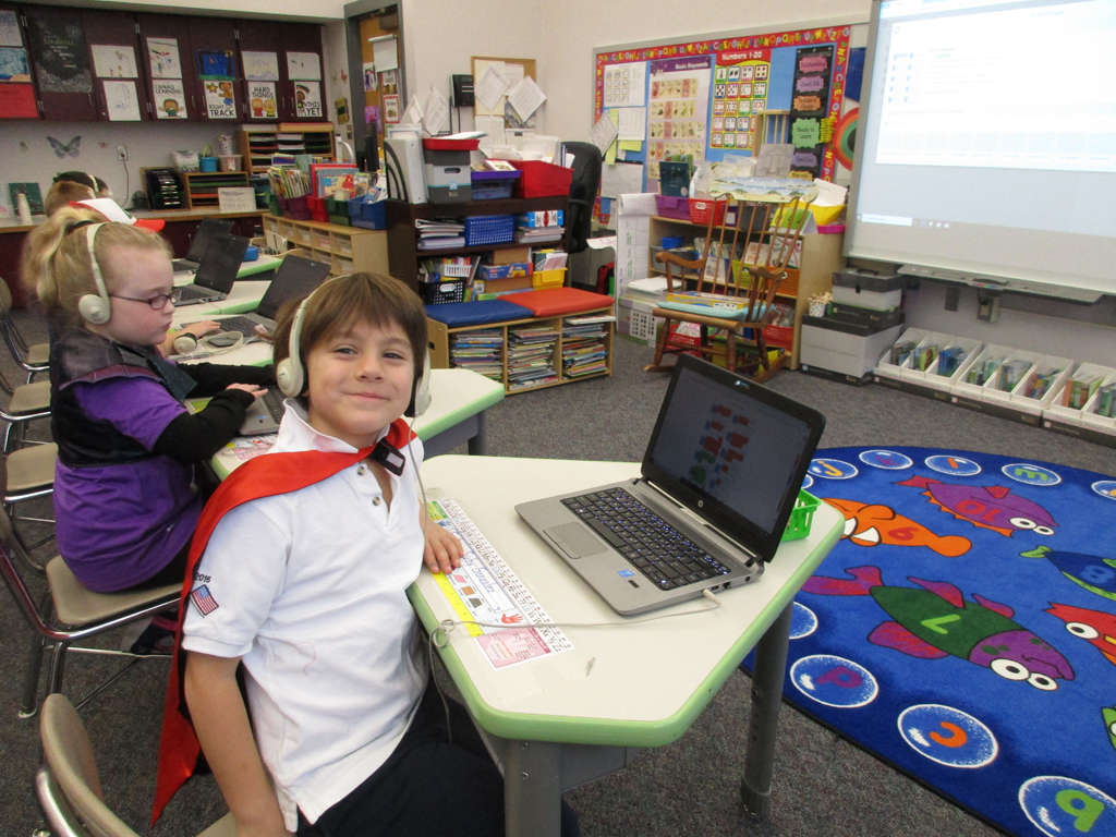 Grade 1 students using  the SeeSaw site on their laptops