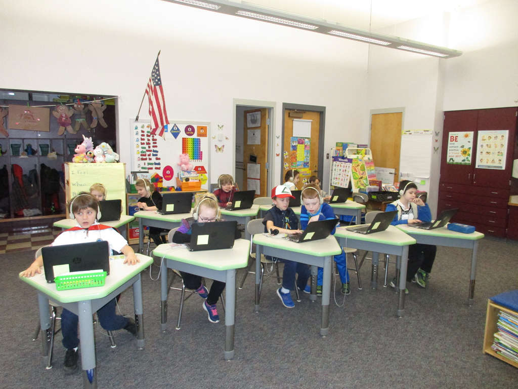 Grade 1 students doing a math activity on laptops